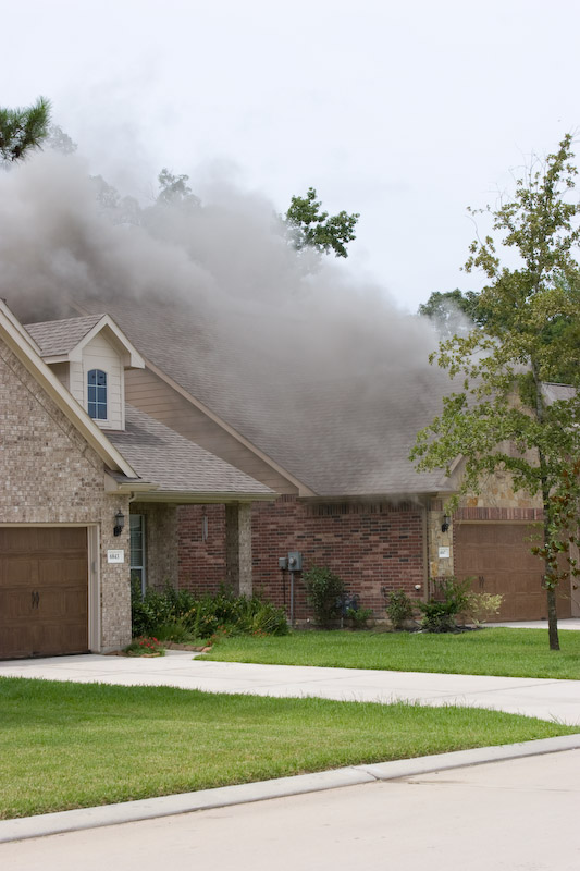 First picture of the smoke coming out of the house.